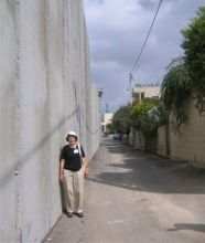 Here Peggy is seen in Bethlehem, next to the wall that Israel is building between Israel and Palestine.